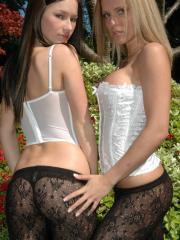 Kate and Karen show off their sexy asses in the garden