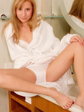 Beautiful Odette drops her white bath robe to the floor