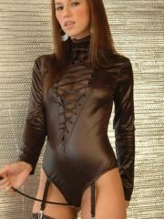 Dominatrix Kate loves to play with her whip as she strips out of her little tight outfit