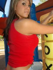 Rio has a little fun at the playground in her tight jeans with red lace panties underneath