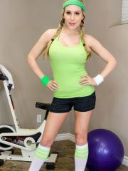 Busty girl Katie Banks gets hot while working out and takes off her clotehs