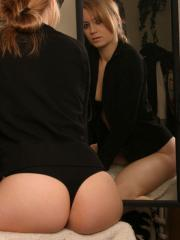 Blonde babe Kristin gets out of her fur jacket and teases by the mirror