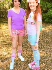 Redhead teen Krystal Orchid has some lesbian fun outside with her friend