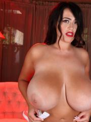 Busty pinup babe Leanne Crow shows you her enormous honkers