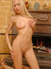 Pictures of Lovely Anne stripping down naked next to the fireplace
