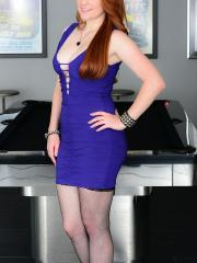 Lucy wears her tight dress and fishnets while she cums on her purple dildo