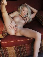 Hot blonde Nika N strips completely nude and flaunts her stunning body
