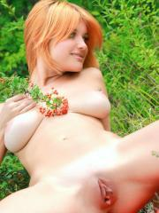 Stunning redhead Violla A displays her beautiful body like a flower in the garden