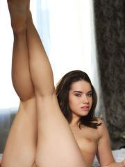 Beautiful girl Aza gets completely naked and crawls into bed for you
