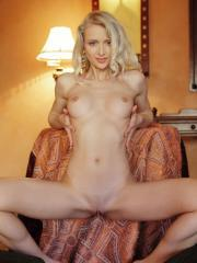 Blonde beauty Nika N slides down her sexy body suit
