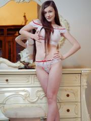 Beautiful girl Emily Bloom slips off her white sheer lingerie and shows you her amazing nude body