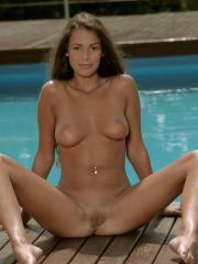 Brunette beauty Lia Taylor strips out of her bikini by the pool