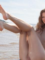 Stunning blonde Patritcy A strips naked and gets all wet on a beach