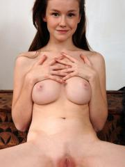 Emily Bloom gets naked and shows you her tight little pussy