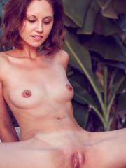 Sade Mare playfully poses in the veranda baring her lean body with perky nipples and yummy pussy