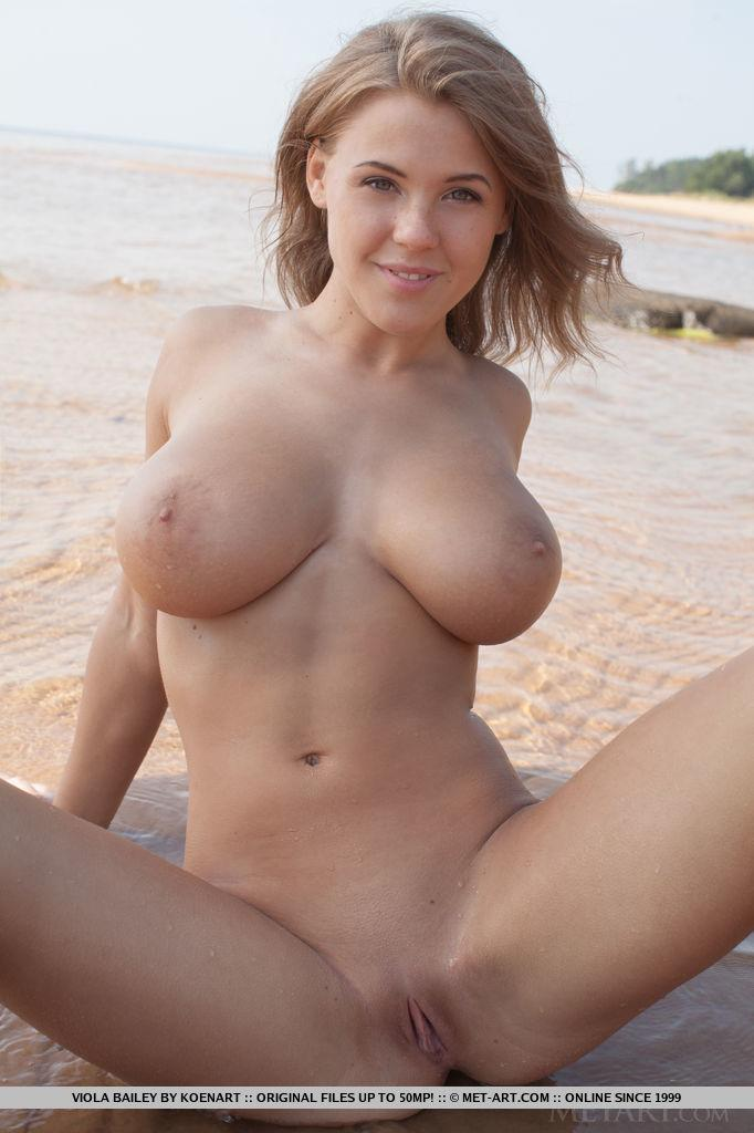 Busty beauty Viola Paige gets naked for you on the beach ...