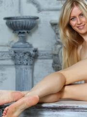 "Gorgeous blonde Tamara F strips out of her yellow dress in ""Thiona"""