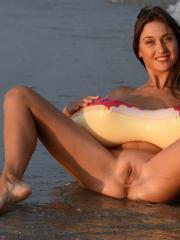 Brunette hottie Shannon gives you her tight pussy on the beach