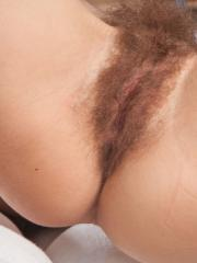Redhead girl Lucia D shows you her hairy bush in Eramni