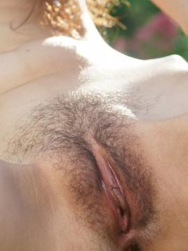 Djessy bares her petite body and trimmed pussy outdoors