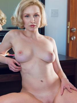 """Busty blonde Kery displays her nude body in """"Athoe"""""""