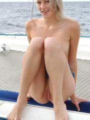 Pictures of hot blonde Mila giving you her pussy on a boat