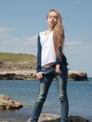 Blonde teen Milena D shows off her tight body in the water