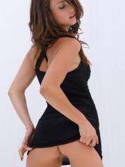 Malena Morgan strips out of her black dress and displays her amazing body