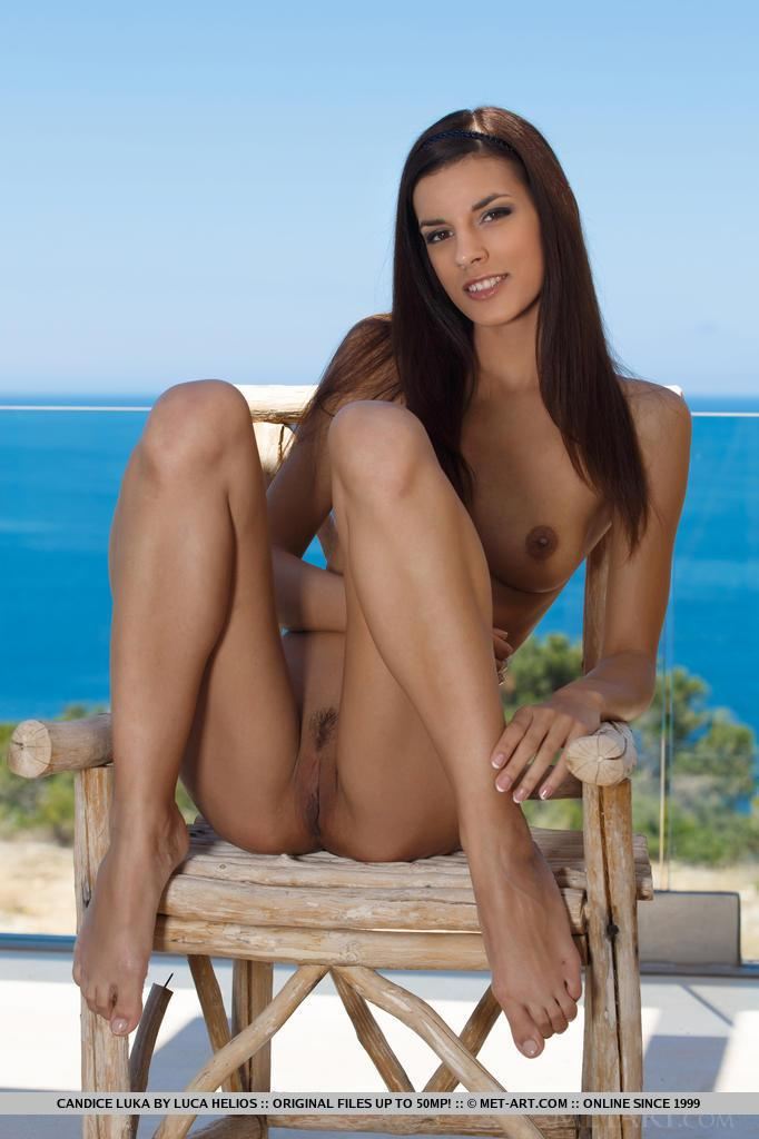 Brunette beauty Candice Luka strips nude and displays her ...