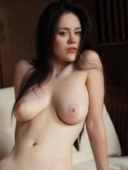Busty brunette hottie Annis A strips naked in bed for you