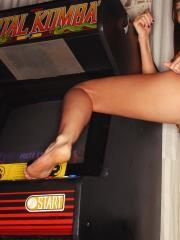 Old school arcade cabinets are no match for Misty! She fucks the joystick of Mortal Kombat as a finishing move!