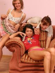 Pictures of teen girl Molly spreading her legs on the sofa