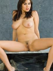 Busty brunette Mai Ly strips completely nude and spreads for you