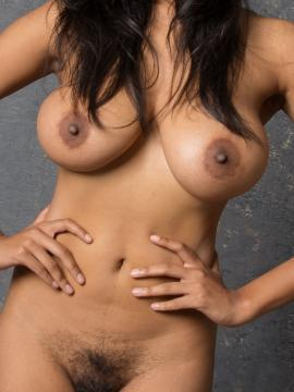 Busty babe Sabine shows off her curvy body in the studio
