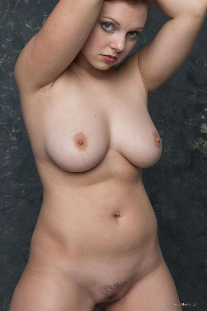 Busty redhead shows us her big naturals and hairy pussy 2