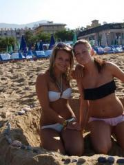 Hot college coeds have fun on a beach