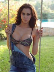 Beautiful girl Jennifer Ann starts stripping for you on her swing