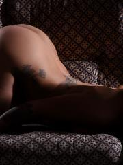 Beautiful alt babe Mica Martinez shows off her sexy little ass on the sofa