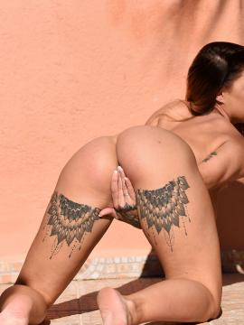 Mica Martinez strips out of her white body-suit outside
