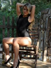 Glam model Rachel McDonald strips out of her black one-piece outside
