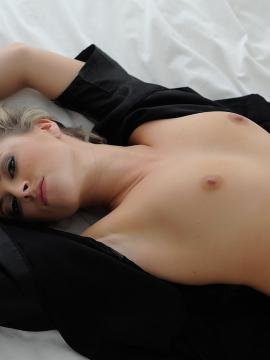 Blonde babe Rachel McDonald shows off her perky boobs in bed