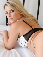 Blonde babe Rachel McDonald gives you a striptease in bed