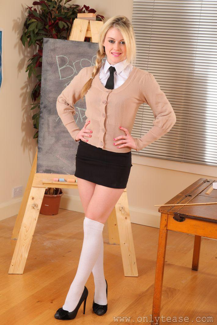 Busty schoolgirl strips and slaps her butt with a ruler 9