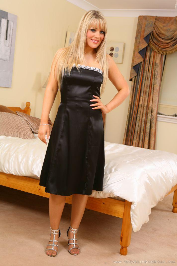 Brandy Shows Off Her Sexy Curves In This Figure Hugging Black Satin -4539