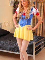 Samantha K teases her way out of her Snow White outfit.