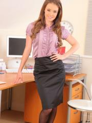 Beauty secretary slowly removes her skirt and top.