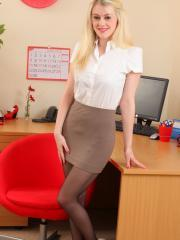 Busty babe Brooke in the office in black suspenders