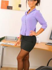 Busty brunette Emma T strips and teases in her sexy secretary outfit