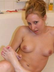 Pictures of Rachel playing with her perfect feet in the bath tub