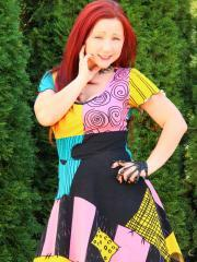 Redhead girl Sexy Pattycake teases in her colorful dress
